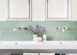 Neutral Colored Bathrooms - white subway tile bathroom modern with neutral colors freestanding