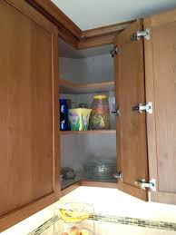 under upper cabinet lighting cabinet upper modern kitchen with red pots on stove cabinet uppers