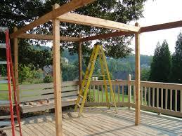 excellent outdoor kitchen decoration using solid oak wood pergola