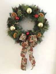 large artificial wreath in a frosted green leaf also