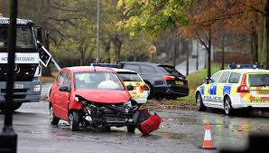 vauxhall corsa black police at the scene of an rtc involving an black audi and a red