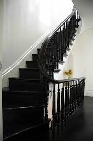 refinished glossy black painted stair by elizabeth roberts