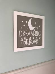 nursery wall decor dream big little one sign with moon and stars 24 x 24 inch grey sign with white frame reading in white dream big little one with stars and a half moon
