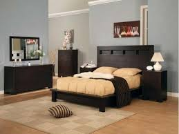 Classy Bedroom Colors by Classy Double Bed On Wooden Floor Under Interesting Lighting Near