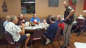 round table grand lake grand haven tribune having coffee with a cop