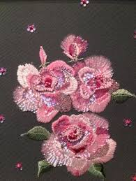 another example of embroidered flowers in sequins and beads haute