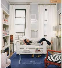 how to be a pro at small apartment decorating think vertical
