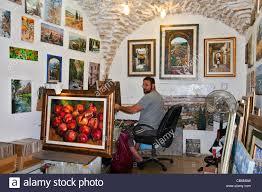artist working in his studio artist quarter old city tzfat