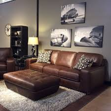 Leather Furniture Family Room With Warm Gray Walls Black And White Art Brown