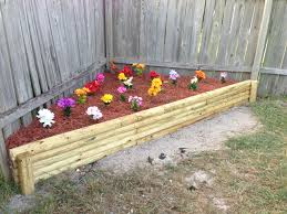 out doors decoration a caddy corner fake plant garden with mulch