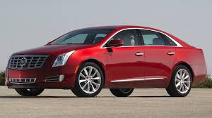 lincoln mks vs cadillac xts 2014 cadillac xts buyers guide autoweek