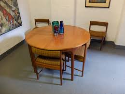 sold sold teak round extending dining table with 6 chairs by