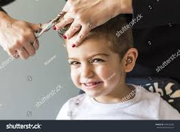 cute young boy getting haircut home stock photo 549029200