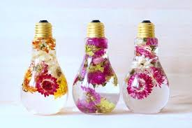 in light bulbs flower light bulb vase suspends beautiful blooms like prized jewels