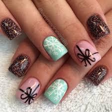 glitter nails snowflake nails present bow nails christmas nails