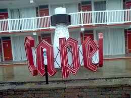 cape cod inn lighthouse rotating neon sign obnoxious antiques