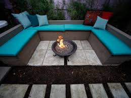 outdoor tropical themed backyard fire pit with square pit and