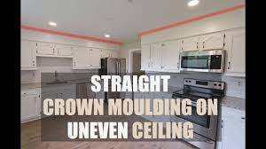 how to install cabinets with uneven ceiling how to install crown moulding on uneven ceiling hide wavy ceiling with crown