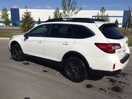 subaru outback 2018 white yellow fog lights look sick on this blacked out outback car