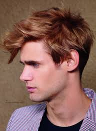 very short in back and very long in front hair men s haircut with a very short back and a color contrast