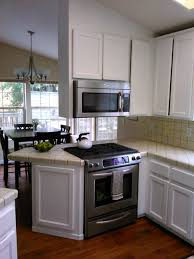 can i use epoxy paint on wood cabinets oak cabinets painted white with km epoxy paint kitchen aid