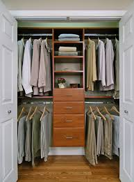 bedroom simple and neat closet design with brown wooden closet