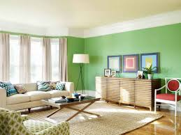 comfortable living room interior with green painted wall accents