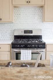green kitchen backsplash tile kitchen makeover sunflower ming green and thassos white