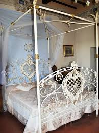 beautifully detailed white wrought iron bed with canopy frame