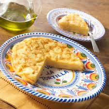 tortilla espanola and ceramic serving plate