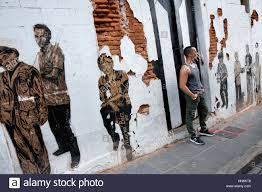 man standing with painted wall mural san juan puerto rico stock man standing with painted wall mural san juan puerto rico