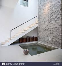 entrance hall with indoor pond house of an art collector on the