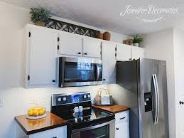 how to decorate space above kitchen cabinets how to decorate above kitchen cabinets decorates