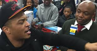 in case you missed it rapper t i surprises walmart shoppers by