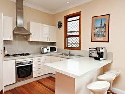 peninsula brown wooden kitchen cabinets u shaped wood tracking
