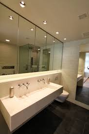 bathroom with large wall mirror design also cool recessed lighting