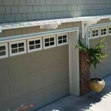 arbor over garage door with mandevilla vine completed projects