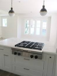White Kitchens With Islands by Wooden Kitchen Island With Modern Stove Top On Glossy Brown Marble