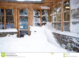 Snow At Home by Austrian Wooden House With Big Windows Covered By Snow At Snowst