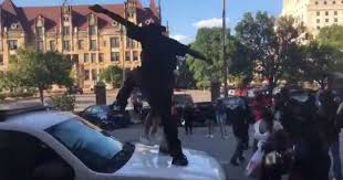 where do you put a st video st louis rioters put little kid on police car to help