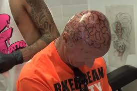 why did this man get 60 baked beans tattooed on his head mirror