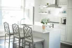 home tour kitchen dining area medicine manicures modern white kitchen grey bamboo barstools