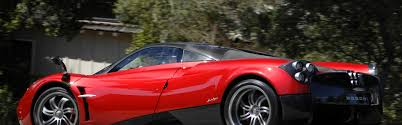 pagani huayra red download wallpaper 3840x1200 pagani huayra supercar red side