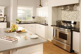 granite countertop white kitchen cabinets with backsplash