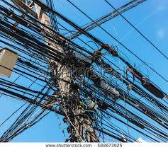 intertwining many electrical wires on poles stock photo 133154174