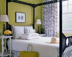 lime green bedroom showing green wall and twin white table lamps