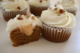 maple frosting pumpkin spice cupcakes with delce de leche cream filling topped