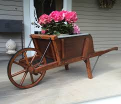 large wooden wheelbarrow with removable sideboards