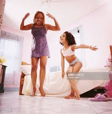 mother and daughter dancing in girls bedroom stock photo getty