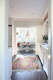 Galley Kitchen Rugs A Colorful Rug Adorns A Galley Kitchen By Meares